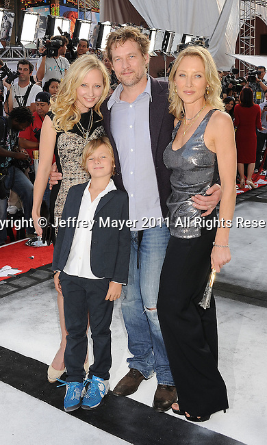 "HOLLYWOOD, CA - SEPTEMBER 25: Anne Heche, James Tupper and Abigail Heche attend Premiere Of ""Iris"" - A Journey Into The World Of Cinema By Cirque du Soleil at the Kodak Theatre on September 25, 2011 in Hollywood, California."