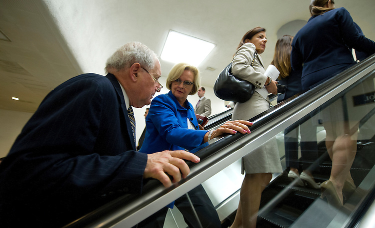 UNITED STATES - July 18: Sen. Carl Levin, D-MI., and Sen. Claire McCaskill, D-MO., talk as they make there way to the Senate policy luncheons through the Senate subway in the U.S. Capitol on July 18, 2013. (Photo By Douglas Graham/CQ Roll Call)