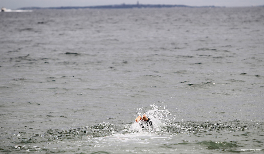 Josh Blake heads out from Pirates Cove Beach in Rye, N.H., Sunday, Sept. 2, 2012, to swim to the Isles of Shoals.  (Portsmouth Herald Photo Cheryl Senter)