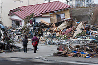 Survivors search for possessions in the effects of the tsunami that struck north east Japan on March 11th Kamaishi,, Iwate, Japan. March 17th 2011