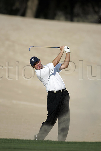 3 March 2005: South African golfer Ernie Els (RSA) looks into the distance after playing an iron from the bunker during round one of the Dubai Desert Classic held at the Emirates Golf Club, Dubai, United Arab Emirates. Photo: Neil Tingle/actionplus..050303 male man men golf golfer sand trap