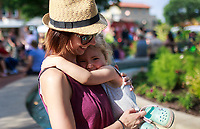 NWA Democrat-Gazette/CHARLIE KAIJO Karmin Keller of Bella Vista embraces Alexa Keller, 3, during the First Friday event, Friday, July 6, 2018 at the Downtown Square in Bentonville. <br />
