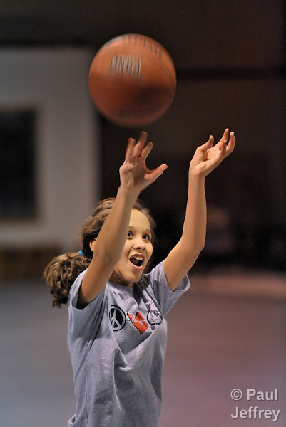 A girl shoots a basketball in the gym at the Cookson Hills Center in Cookson, Oklahoma.