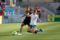 FC Gold Pride forward Marta (10) battles for the ball with Red Stars defender Lydia Vanderbergh (21).  The FC Gold Pride defeated the Chicago Red Stars 3-2 at Toyota Park in Bridgeview, IL on August 22, 2010