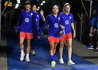 CHARLOTTE, NC - OCTOBER 03: Tobin Heath #17, Mallory Pugh #2 and Morgan Brian #6 of the United States walk out to warm up prior to their game versus Korea Republic at Bank of American Stadium, on October 03, 2019 in Charlotte, NC.