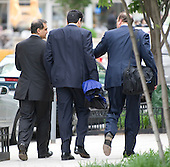 Washington, DC - May 14, 2009 -- Former F.B.I. Agent Mark Rossini, boyfriend of actress Linda Fiorentino, center, leaves U.S. District Court in Washington, D.C. with his attorney Adam Hoffinger, right, and his brother John Rossini, left, after being sentenced to a year's probation and a $5,000 fine for his role in illegally accessing F.B.I. documents..Credit: Ron Sachs / CNP .(RESTRICTION: NO New York or New Jersey Newspapers or newspapers within a 75 mile radius of New York City)