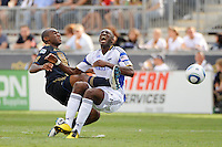 Amobi Okogu (14) of the Philadelphia Union catches Birahim Diop (27) of the Kansas City Wizards in the stomach. The Philadelphia Union and the Kansas City Wizards played to a 1-1 tie during a Major League Soccer (MLS) match at PPL Park in Chester, PA, on September 04, 2010.