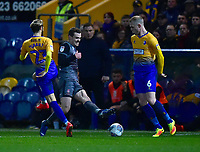 Lincoln City's Harry Toffolo vies for possession with  Mansfield Town's Jorge Grant and Neal Bishop<br /> <br /> Photographer Andrew Vaughan/CameraSport<br /> <br /> The EFL Sky Bet League Two - Mansfield Town v Lincoln City - Monday 18th March 2019 - Field Mill - Mansfield<br /> <br /> World Copyright © 2019 CameraSport. All rights reserved. 43 Linden Ave. Countesthorpe. Leicester. England. LE8 5PG - Tel: +44 (0) 116 277 4147 - admin@camerasport.com - www.camerasport.com