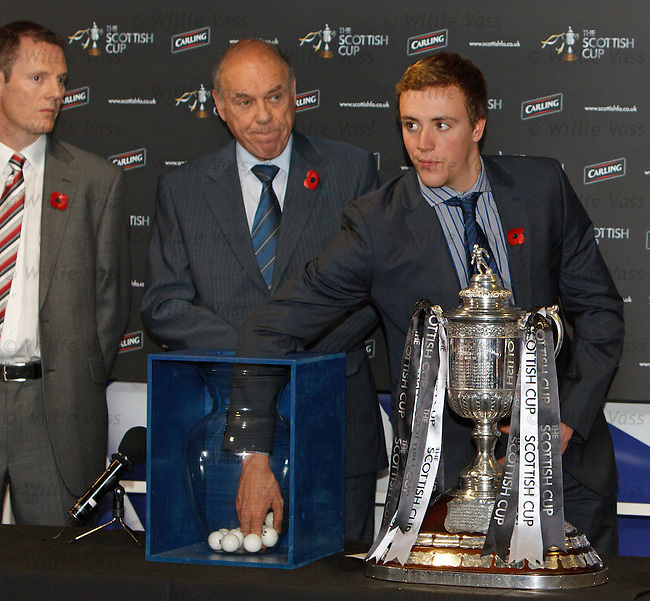 Commonwealth gold medallist Robbie Renwick helps draw out some balls for the Scottish Cup draw