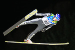 Mikhail Maksimochkin jumps during the Large Hill Ski Jumping event as part of the Winter Universiade Trentino 2013 on 20/12/2013 in Predazzo, Italy.<br /> <br /> &copy; Pierre Teyssot - www.pierreteyssot.com