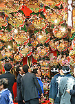 """November 8, 2012, Tokyo, Japan - Bargain hunters crowd around the stalls decorated with colorful good-luck bamboo rakes in the precinct of a downtown Tokyo shrine during """"Tori-no-Ichi,"""" an annual open-air market, on Thursday, November 8, 2012...Since the 18th century, in November each year on the day of rooster in the Chinese zodiac, Japanese across the country have visited their neighborhood shrines and temples to buy ornamented bamboo rakes which are said to """"rake up health, good fortune and good business. (Photo by Natsuki Sakai/AFLO) AYF -mis-"""