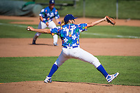Ogden Raptors starting pitcher Jairo Pacheco (11) looks for the sign against the Grand Junction Rockies in Pioneer League action at Lindquist Field on July 5, 2015 in Ogden, Utah. Ogden defeated Grand Junction 12-2.  (Stephen Smith/Four Seam Images)