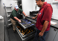 NWA Democrat-Gazette/CHARLIE KAIJO Jerod Bradshaw, WIOA program coordinator, (from left) gives a tour to assistant store manager, Carlos Villa, inside of a mobile construction lab, Thursday, September 13, 2018 at Lowes in Bella Vista.<br /><br />The Arkansas Department of Higher Education gave NWACC $1 million workforce grant, which will allow the college to continue help training high school students in the construction trades.<br /><br />Last year the college was able to buy a mobile lab equipped with a bunch of construction tools. This year the lab will go to high schools throughout Benton and Washington counties so students can gain experience with tools their schools don&Otilde;t have.<br /><br />They hope to have a second truck operating in about six months.