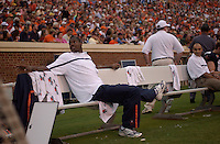 24 September 2005:  Virginia tackle D'Brickashaw Ferguson watches from the bench during the second half after spraining his knee during the first quarter.  Virginia Cavaliers defeated the Duke Blue Devils 38-7 at Scott Stadium in Charlottesville, VA.