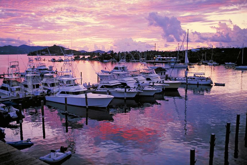 American Yacht Harbor sunrise silhouette with docks & fishing boats. St Thomas, US Virgin Islands Caribbean.