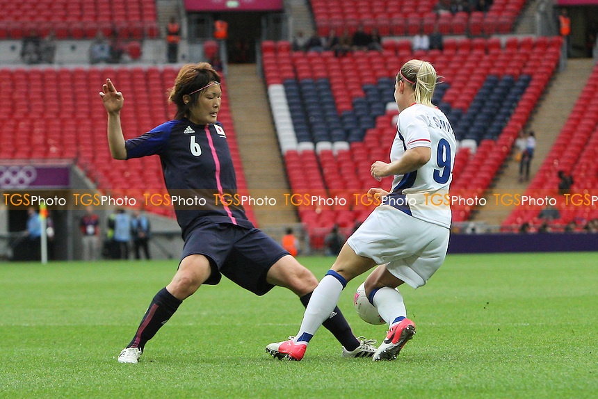 Mizuho SAKAGUCHI of Japan trips Eugenie LE SOMMER of France in the area and a penalty is awarded - France Women vs Japan Women - Womens Olympic Football Tournament London 2012 Semi-Final at Wembley Stadium - 06/08/12 - MANDATORY CREDIT: Gavin Ellis/SHEKICKS/TGSPHOTO - Self billing applies where appropriate - 0845 094 6026 - contact@tgsphoto.co.uk - NO UNPAID USE.