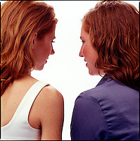 Rear view of two red haired women