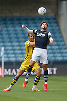 Tom Bradshaw of Millwall and Ben Wilmot of Swansea City during Millwall vs Swansea City, Sky Bet EFL Championship Football at The Den on 30th June 2020