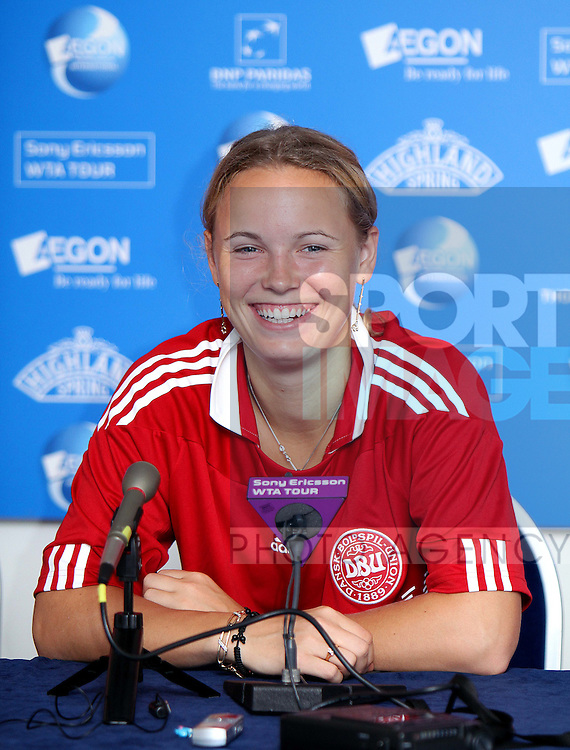 Caroline Wozniacki of Denmark attends her press conference wearing a Denmark football shirt