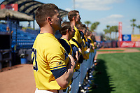 Michigan Wolverines head coach Erik Bakich (23) and his team stand for the national anthem before a game against Army West Point on February 17, 2018 at Tradition Field in St. Lucie, Florida.  Army defeated Michigan 4-3.  (Mike Janes/Four Seam Images)