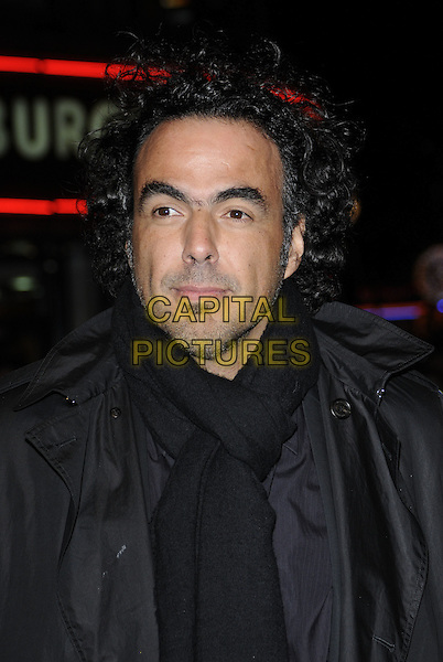 """ALEJANDRO GONZALEZ INARRITU .At the """"Biutiful"""" premiere during the 54th BFI London Film Festival, Vue West End Cinema, London, England, UK, .26th October 2010..portrait headshot  black scarf grey gray .CAP/CAN.©Can Nguyen/Capital Pictures."""