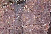 Crawford Notch State Park - Initials and dates carved into the rocky ledge at the Mt. Willard Section House location. This house was located at the end of the Willey Brook Trestle along the Maine Central Railroad in the White Mountains, New Hampshire USA. It was built in 1887 to house the section foreman and crew who maintained the track along the face of Crawford Notch. It was destroyed by fire in 1972