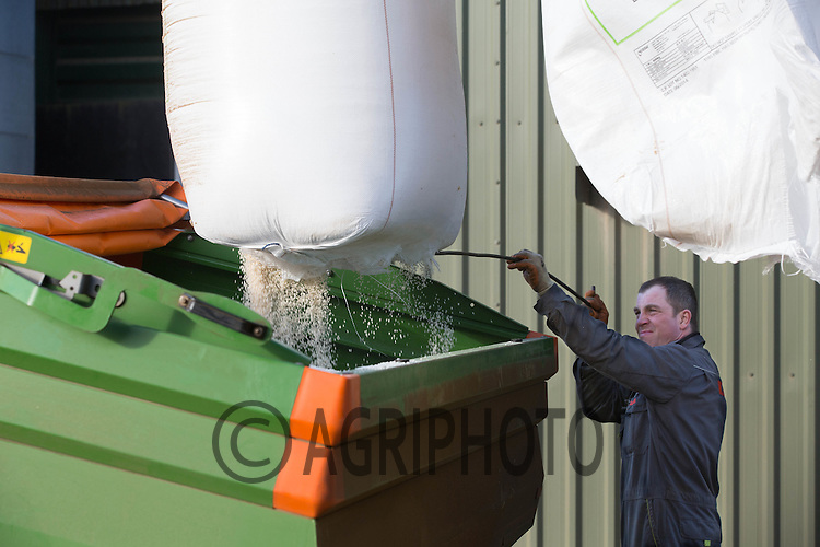 Loading nitrogen into to a spreader in a farmyard<br /> Picture Tim Scrivener 07850 303986