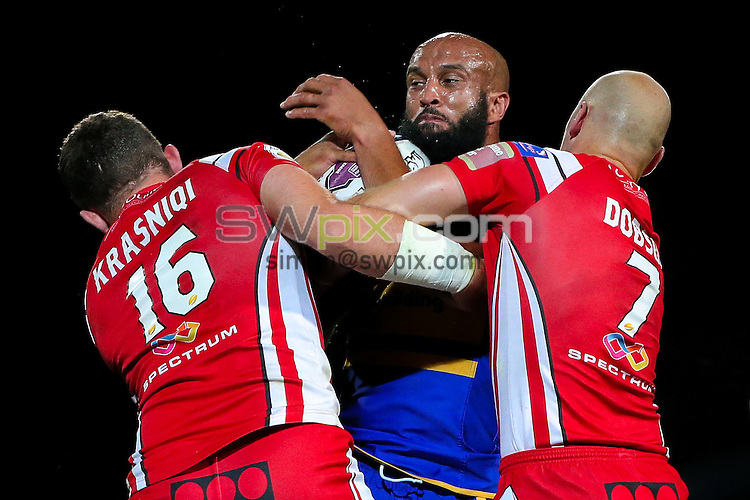 Picture by Alex Whitehead/SWpix.com - 02/09/2016 - Rugby League - First Utility Super League - Leeds Rhinos v Salford Red Devils - Headingley Carnegie Stadium, Leeds, England - Leeds' Jamie Jones-Buchanan is tackled by Salford's Oli Krasniqi and Michael Dobson.