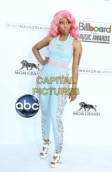 NICKI MINAJ.2011 Billboard Awards arrivals at the MGM Grand Garden Arena, Las Vegas, Nevada, USA..May 22nd, 2011.full length blue pink sheer jumpsuit dyed hand on hip hair beads beaded tongue funny.CAP/ADM/MJT.© MJT/AdMedia/Capital Pictures.