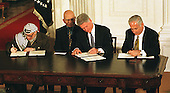 Washington, DC - October 23, 1998 -- The Wye River Accords are signed at a White House ceremony on Thursday, October 23, 1998.  Left to right: Palestinian Authority Chairman Yasser Arafat; King Hussein of Jordan;  United States President Bill Clinton; Prime Minister Binyamin Netanyahu of Israel..Credit: Ron Sachs / CNP