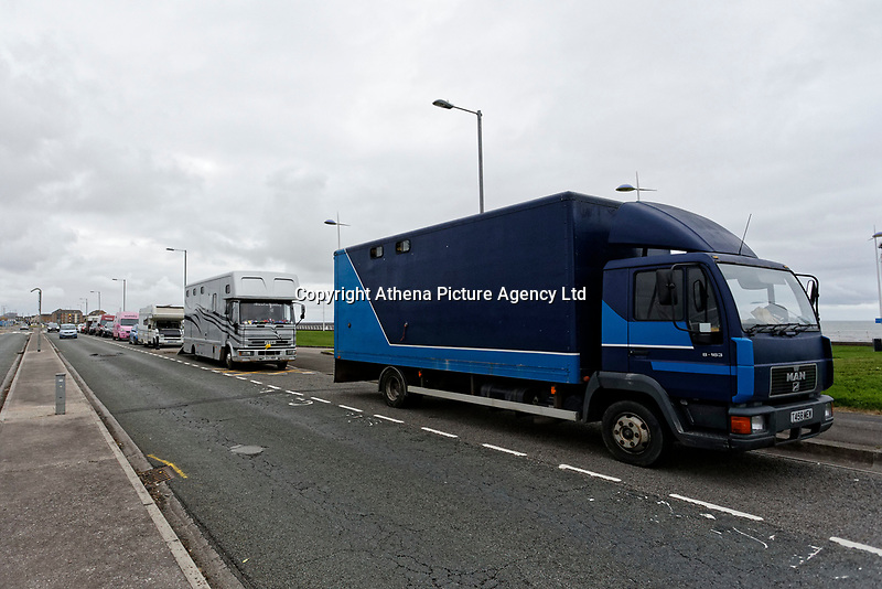 """Pictured: Dozens of horse boxes parked outside Aberavon Beach Hotel in Port Talbot, Wales, UK. Monday 08 October 218<br /> Re: A grieving father will mourners on horseback at the funeral of his """"wonderful"""" son who killed himself after being bullied at school.<br /> Talented young horse rider Bradley John, 14, was found hanged in the school toilets by his younger sister Danielle.<br /> Their father, farmer Byron John, 53, asked the local riding community to wear their smart hunting gear at Bradley's funeral.<br /> Police are investigating Bradley's death at the 500-pupils St John Lloyd Roman Catholic school in Llanelli, South Wales.<br /> Bradley's family claim he had been bullied for two years after being diagnosed with Attention Deficit Hyperactivity Disorder.<br /> He went missing during lessons and was found in the toilet cubicle by his sister Danielle, 12."""