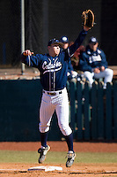 First baseman Brett Huffman #41 of the Catawba Indians is pulled off the bag by a high throw February 14, 2010 in Salisbury, North Carolina.  Photo by Brian Westerholt / Four Seam Images