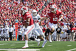 Wisconsin Badgers quarterback Alex Hornibrook (12) hands the ball off to running back Jonathan Taylor (23) during an NCAA College Football game against the Florida Atlantic Owls Saturday, September 9, 2017, in Madison, Wis. The Badgers won 31-14. (Photo by David Stluka)