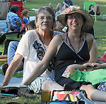 Lyn Hardy, sitting in the audience with her daughter, Ruth Unger Merenda, and granddaughter, Opal Merenda, on Hoot Hill, on third-and-final day of the 4th Annual Summer Hoot Festival, held at the Ashokan Center in Olivebridge, NY, on Sunday, August 28, 2016. Photo by Jim Peppler; Copyright Jim Peppler 2016.