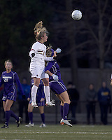 "Boston College midfielder Kate McCarthy (21) and University of Washington forward McKenna Waitley (14) battle for head ball. In overtime, Boston College defeated University of Washington, 1-0, in NCAA tournament ""Elite 8"" match at Newton Soccer Field, Newton, MA, on November 27, 2010."