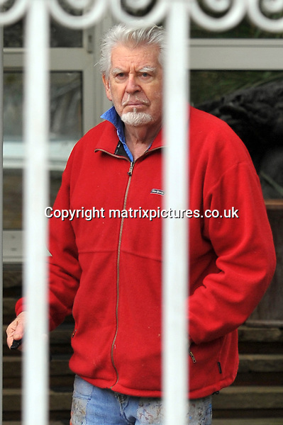 EXCLUSIVE PICTURE: MATRIXPICTURES.CO.UK.PLEASE CREDIT ALL USES..WORLD RIGHTS..***FEES TO BE AGREED BEFORE USE***NO WEB USE WITHOUT CONSENT***FEES TO BE AGREED BEFORE USE***NO WEB USE WITHOUT CONSENT***..Australian entertainer Rolf Harris is spotted returning to his Berkshire home with a friend and a dog...JANUARY 12th 2013..***FEES TO BE AGREED BEFORE USE***NO WEB USE WITHOUT CONSENT***FEES TO BE AGREED BEFORE USE***NO WEB USE WITHOUT CONSENT***..REF: MTX 13205