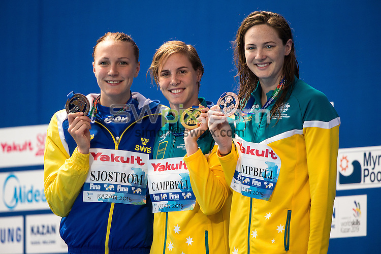Picture by Alex Whitehead/SWpix.com - 07/08/2015 - Swimming - 16th FINA World Swimming Championships 2015 - Kazan Arena Stadium, Kazan, Russia - Australia's Bronte Campbell celebrates winning Gold in the Women's 100m Freestyle final, Silver - Sweden's Sarah Sjostrom, Bronze - Australia's Cate Campbell.