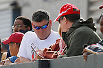 Fans looking over their racing form after race #1 at Oaklawn Park. (Justin Manning/Eclipse Sportswire)