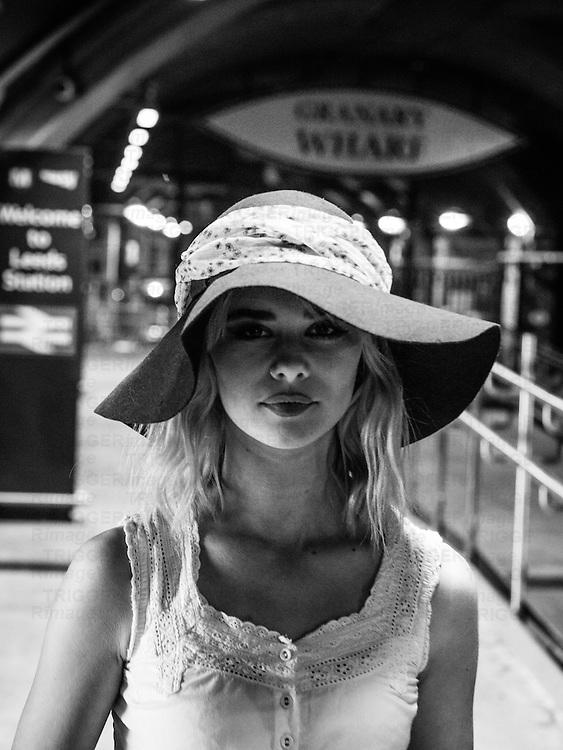Shot of blonde model with hat under Leeds station