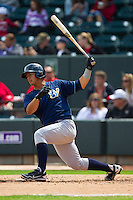 Cheslor Cuthbert (32) of the Wilmington Blue Rocks follows through on his swing against the Winston-Salem Dash at BB&T Ballpark on April 21, 2013 in Winston-Salem, North Carolina.  The Blue Rocks defeated the Dash 5-3.  (Brian Westerholt/Four Seam Images)