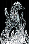 Sculpture of a seahorse made of ice illuminated at night