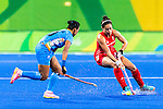 Sam Quek #13 of Great Britain turns to evade Anuradha Thokchom #10 of India during India vs Great Britain in a Pool B game at the Rio 2016 Olympics at the Olympic Hockey Centre in Rio de Janeiro, Brazil.