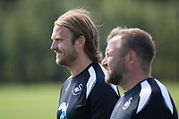 (L-R) Bjorn Hamberg, assistant coach and Billy Reid, assistant manager watch the players train during the Swansea City Training Session at The Fairwood Training Ground, Wales, UK. Tuesday 03 July 2018