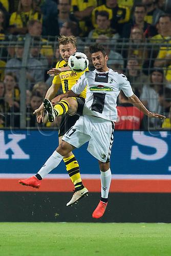 23.09.2016. Dortmund, Germany. German Bundesliga Football. Borussia Dortmund versus SC Freibrug.   Marcel Schmelzer (BVB) and Onur Bulut (SCF)