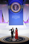 United States President Barack Obama (L) and first lady Michelle Obama greets attendees at the Commander-in-Chief Ball on January 21, 2013 in Washington, DC. Pres. Obama was sworn-in for his second term as president during a public ceremonial inauguration earlier in the day.  .Credit: Justin Sullivan / Pool via CNP