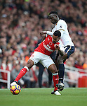 Arsenal's Theo Walcott tussles with Tottenham's Victor Wanyama during the Premier League match at the Emirates Stadium, London. Picture date November 6th, 2016 Pic David Klein/Sportimage