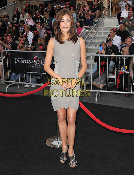 "TERI HATCHER.Premiere of ""Pirates of the Caribbean : On Stranger Tides"" held at Disneyland in Anaheim, California, USA..May 7th 2011.4 four full length dress grey gray sleeveless open peep toe black sparkly ankle boots shoes shooboots .CAP/RKE/DVS.©DVS/RockinExposures/Capital Pictures."