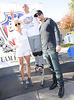"LAS VEGAS, NV - December 8:  Pam Anderson and Jesus ""Half Animal"" Villa and Cris Angelpitcured at Jesus ?Half Animal? Villa Guinness World Record attempt running 310 miles on spring-loaded stilts for ?The Longest Journey? between Las Vegas and Los Angeles from December 8 thru 18 starting on December 8, 2012 in Las Vegas, Nevada.  Credit: Kabik/ Starlitepics/MediaPunch Inc. /NortePhoto"