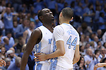 27 December 2014: North Carolina's Theo Pinson (left) congratulates Justin Jackson (44) after Jackson had made back to back three point baskets. The University of North Carolina Tar Heels played the University of Alabama Birmingham Blazers in an NCAA Division I Men's basketball game at the Dean E. Smith Center in Chapel Hill, North Carolina. UNC won the game 89-58.