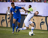 PHILADELPHIA, PA - JUNE 30: Jurien Gaari #13 defends against Paul Arriola #7 during a game between Curaçao and USMNT at Lincoln Financial Field on June 30, 2019 in Philadelphia, Pennsylvania.